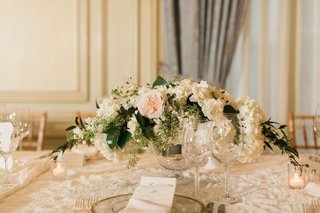 wedding-reception-with-paneled-walls-drapes-neutral-decor-white-hydrangea-greenery-pink-ivory