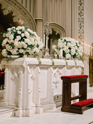 traditional-church-wedding-ceremony-altar-with-white-hydrangea-rose-greenery-flower-arrangements