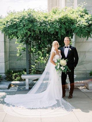bride-in-pronovias-wedding-dress-illusion-neckline-details-cathedral-veil-protea-tropical-bouquet