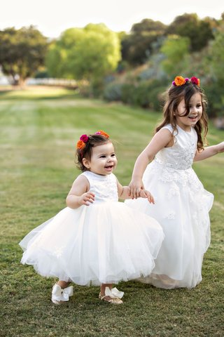 cute-flower-girls-holding-hands-outdoor-grass-glitter-shoes-with-bows-ball-gown-pink-orange-roses