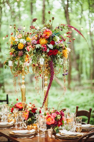 wedding-reception-candelabra-centerpiece-with-gold-red-blue-purple-flowers-greenery