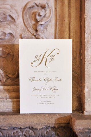 gold-monogram-and-script-on-ceremony-program-for-wedding-at-the-breakers