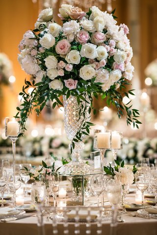 tall-wedding-reception-centerpiece-white-pink-rose-peony-flowers-with-greenery-crystal-vase-candles