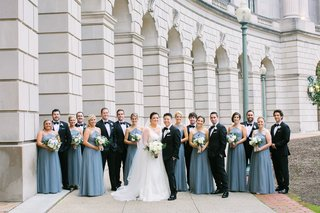 bride-and-groom-with-large-wedding-party-bridesmaids-in-blue-floor-length-bridesmaid-dresses