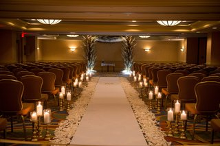 indoor-ceremony-space-gold-concept-hotel-ballroom-jewish-wedding-chuppah-white-runner-candles-petals
