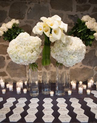 wedding-reception-tall-glass-vases-filled-with-hydrangea-calla-lily-rose-flowers-hexagon-marble