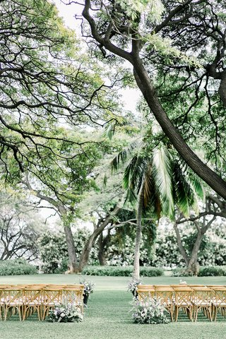 outdoor-wedding-ceremony-hawaii-wood-vineyard-chairs-greenery-white-purple-flowers-palm-trees