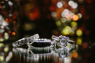 solitaire-engagement-ring-diamond-wedding-band-silver-grooms-wedding-band-on-mirror-surface