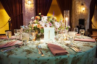 wedding-reception-vintage-inspired-light-blue-linen-with-embellishments-embroidery-pink-napkin