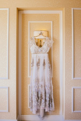 brides-claire-pettibone-dress-with-gold-and-silver-embroidery-smoky-details-flutter-sleeves