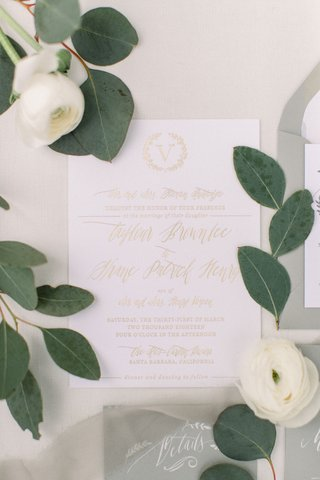 wedding-invitation-white-stationery-gold-foil-monogram-and-script-white-ranunculus-flowers
