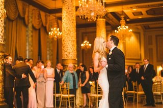 the-drake-hotel-wedding-reception-bride-and-groom-first-dance-guests-watching-gold-decor