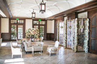flowers-on-mirror-and-table-in-reception-venue-cocktail-hour-lounge-area