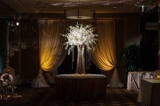 large-floral-display-with-crystals-for-escort-card-table-at-nye-wedding-reception