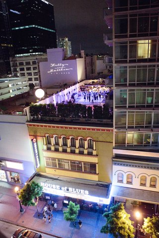 rooftop-wedding-reception-at-hotel-palomar-san-diego-with-purple-lighting-and-couples-names