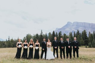 groom-in-ermenegildo-zegna-bride-in-watters-bridesmaids-in-black-sequin-gowns-banff-national-park