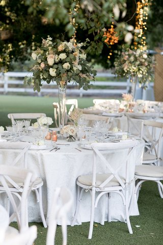 white-and-antique-blush-roses-lisianthus-astilbe-and-eucalyptus-in-tall-glass-vase-centerpieces