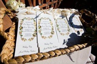 wedding-ceremony-program-ivory-ribbon-pretty-motif-baskets-pretty-calligraphy