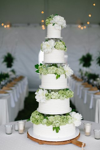 five-layer-wedding-cake-with-green-hydrangea-and-white-peony-flowers-between-each-tier