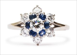 vintage-claremont-ring-in-18k-white-gold-featuring-a-0-25ct-round-brilliant-cut-diamond-with-sapph