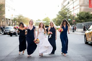 bride-in-v-neck-wedding-dress-and-bridesmaids-in-navy-bridesmaid-gowns-in-middle-of-street-new-york