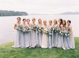 bridesmaids-in-long-blue-grey-cap-sleeve-joanna-august-bridesmaid-dresses-with-blue-ribbon-bouquets