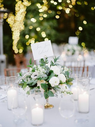 wedding-reception-centerpiece-with-ranunculus-anemone-eucalyptus