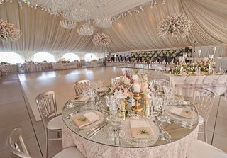 mirror-round-table-with-gold-candlesticks-and-low-flower-centerpiece-around-white-dance-floor
