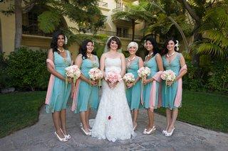 retro-bridesmaids-holding-bouquets-with-amaranthus