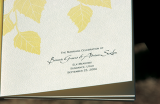 ceremony-program-with-yellow-autumn-leaves