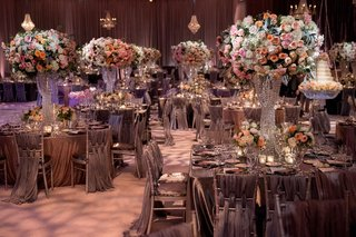 wedding-reception-opulent-crystal-centerpiece-base-with-pink-orange-rose-flowers-and-grey-chairs