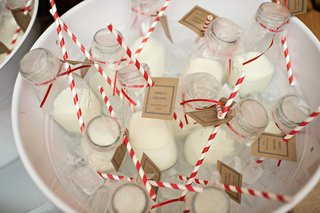 wedding-reception-favors-of-milk-in-old-fashioned-bottles-with-red-and-white-swirl-straws