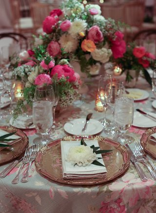 wedding-reception-with-printed-flower-linens-and-bright-centerpieces