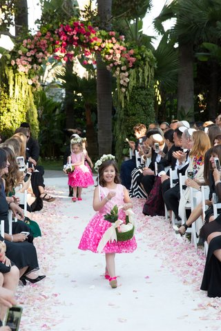 wedding-ceremony-flower-girls-in-pink-dresses-green-baskets-pink-shoes-walking-down-aisle