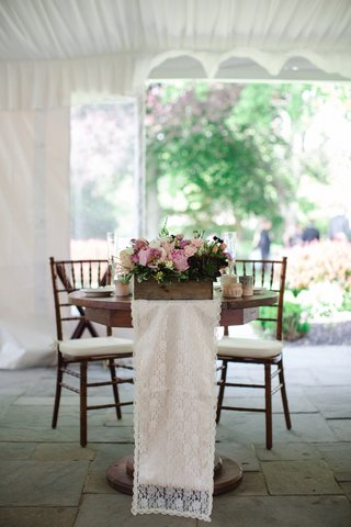 small-wooden-sweetheart-table-with-rustic-centerpiece-and-lace-table-runner