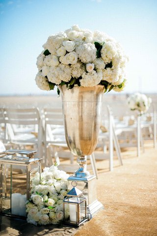 beach-wedding-ceremony-with-tall-silver-urn-white-roses-hydrangeas-lanterns