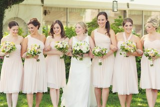 bride-with-girlfriends-outside-holding-bouquets
