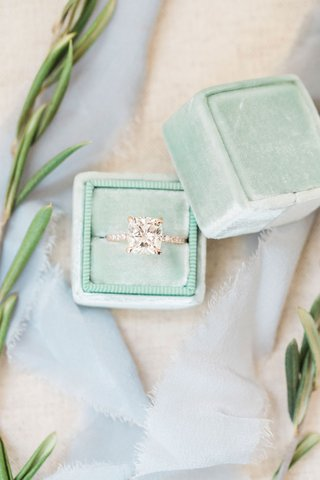 engagement-ring-in-light-mint-green-the-mrs-box-pave-band-rose-gold-cushion-cut-diamond-ring