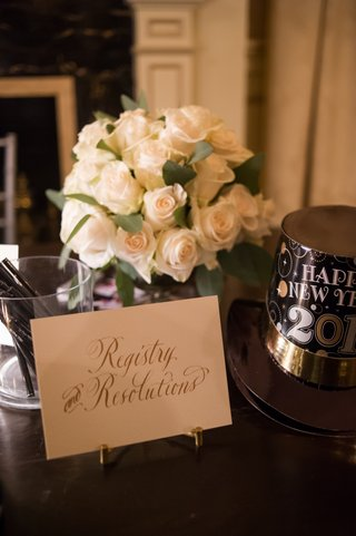 registry-and-resolutions-nye-table-at-wedding