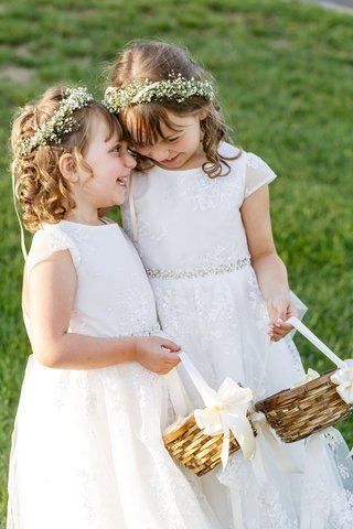 two-flower-girls-with-babys-breath-flower-crown-lace-dresses-baskets-laughing-together