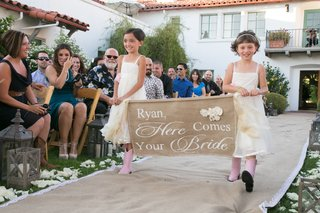 flower-girls-holding-burlap-sign-in-pink-western-boots