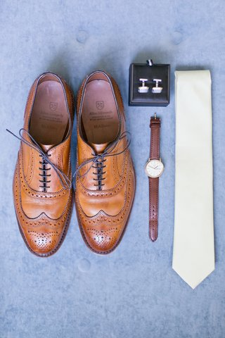 grooms-tan-wing-tip-shoes-watch-with-brown-band-cuff-links-and-pastel-yellow-tie