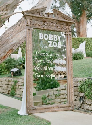 white-text-on-large-free-standing-mirror-at-wedding-ceremony