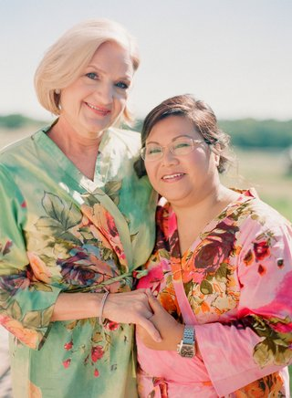 mother-of-the-bride-and-mother-of-the-groom-wear-floral-aqua-and-pink-robes