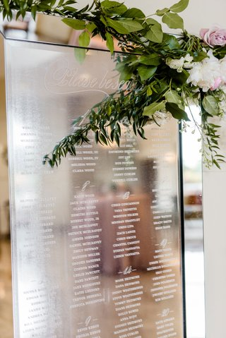 wedding-seating-chart-at-cocktail-hour-mirror-reflective-with-white-etching-alphabetical-find-seat