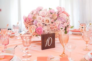 pink-bridal-shower-decor-with-rose-ranunculus-hydrangea-flower-arrangement-pink-glassware-coupe