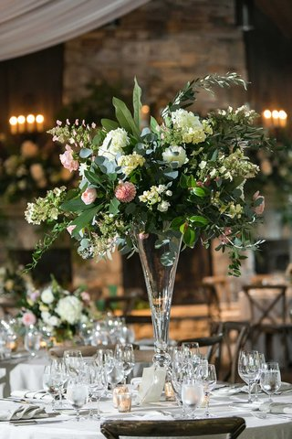 wedding-reception-tall-centerpiece-greenery-pink-dahlia-white-flowers