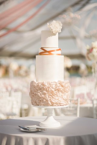 four-tiered-cake-different-sizes-ruffled-layer-bronze-ribbon