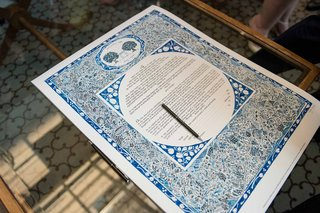 a-traditional-jewish-ketubah-with-blue-details-and-a-floral-design