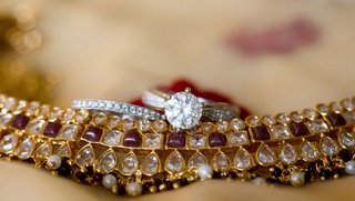 indian-wedding-jewelry-with-solitaire-engagement-ring-and-pave-diamond-band-on-top